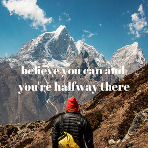 "image of a person from behind standing in front of mountains with the words ""Believe you can and you're halfway there"""